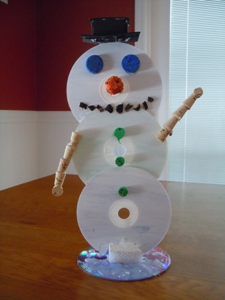 make a snowman from recycled cds